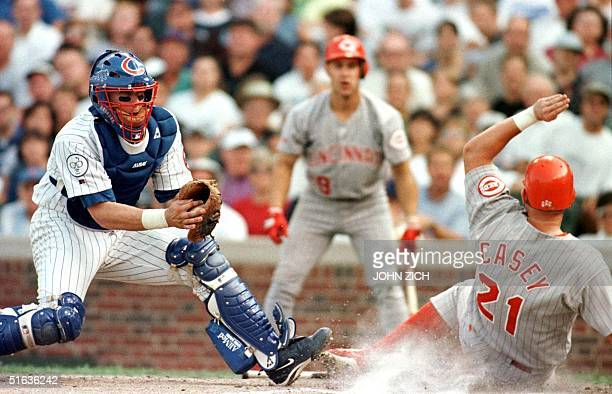 Chicago Cubs' catcher Tyler Houston can't make the tag as Cincinnati Reds' Sean Casey scores on a Dimitri Young double in the sixth inning 19...