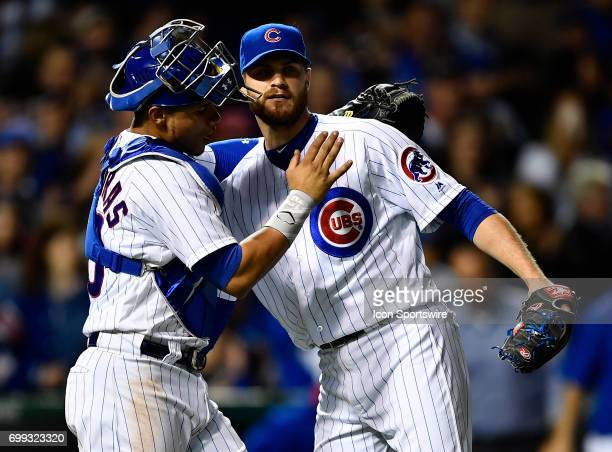 Chicago Cubs catcher Willson Contreras and Chicago Cubs relief pitcher Justin Grimm celebrate after the game between the San Diego Padres and the...