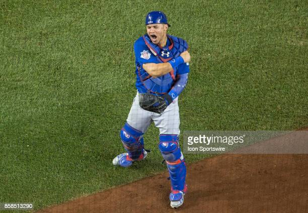 Chicago Cubs catcher Willson Contreras celebrates after making the final out during the the first game of the National League Division Series between...