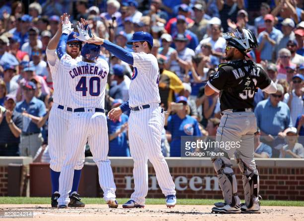 Chicago Cubs catcher Willson Contreras celebrates his threerun home run with Ben Zobrist and Anthony Rizzo as Chicago White Sox catcher Omar Narvaez...
