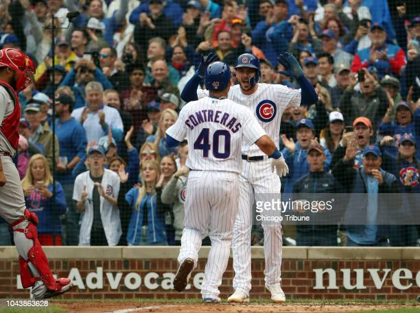 Chicago Cubs catcher Willson Contreras celebrates his tworun home run with Kris Bryant in the fifth inning on Sunday Sept 30 2018 at Wrigley Field in...