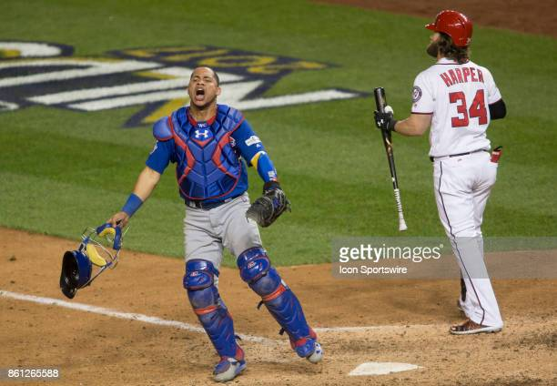 Chicago Cubs catcher Willson Contreras celebrates the Chicago win as Washington Nationals right fielder Bryce Harper strikes out in the ninth inning...