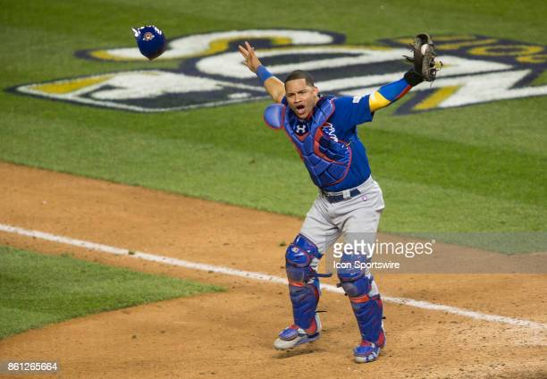 Chicago Cubs catcher Willson Contreras celebrates the Cubs win at the end of game five of the NLDS between the Washington Nationals and the Chicago...
