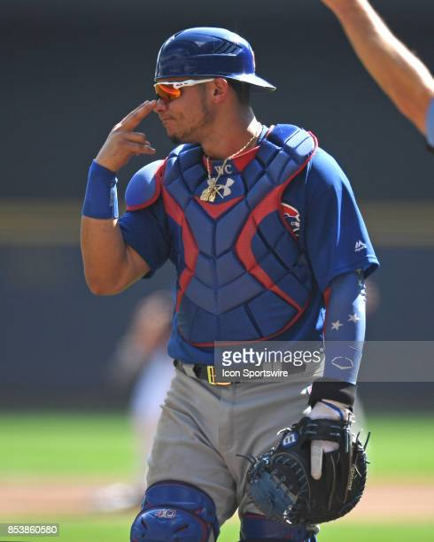 Chicago Cubs catcher Willson Contreras communicates with the bench during a game between the and the Chicago Cubs the Milwaukee Brewers on September...