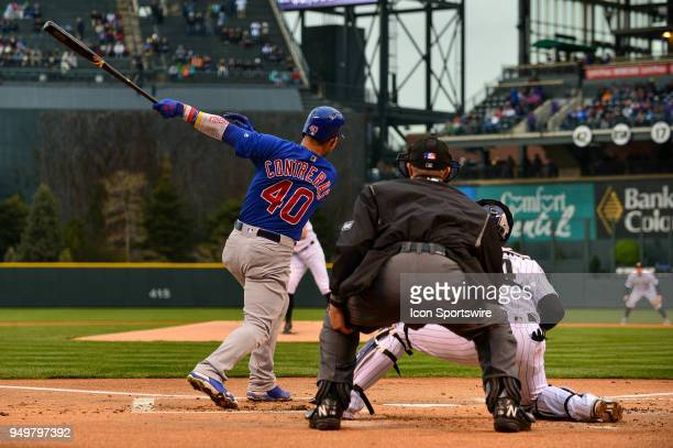 Chicago Cubs catcher Willson Contreras follows through on a 2run first inning double off of Colorado Rockies starting pitcher Tyler Anderson during a...