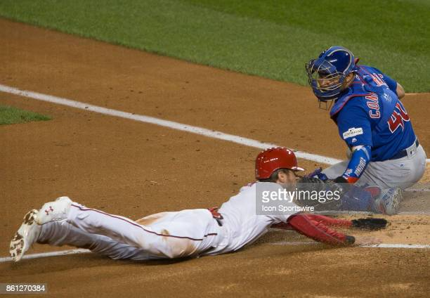 Chicago Cubs catcher Willson Contreras has Washington Nationals shortstop Trea Turner out at home plate during game five of the NLDS between the...