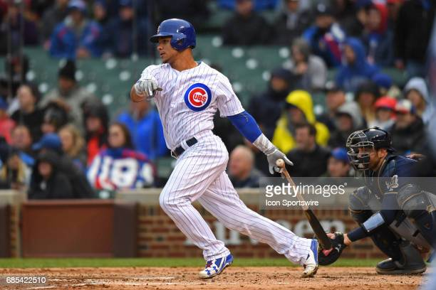 Chicago Cubs catcher Willson Contreras hits a two run RBI single in the fourth inning during a game between the Milwaukee Brewers and the Chicago...