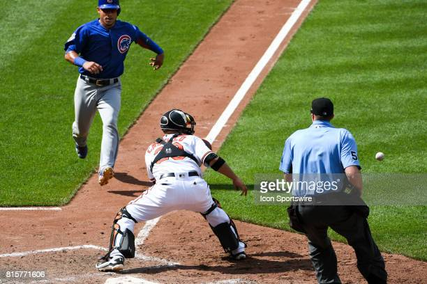 Chicago Cubs catcher Willson Contreras is thrown out a the plate in the ninth inning as the tag is applied by Baltimore Orioles catcher Welington...