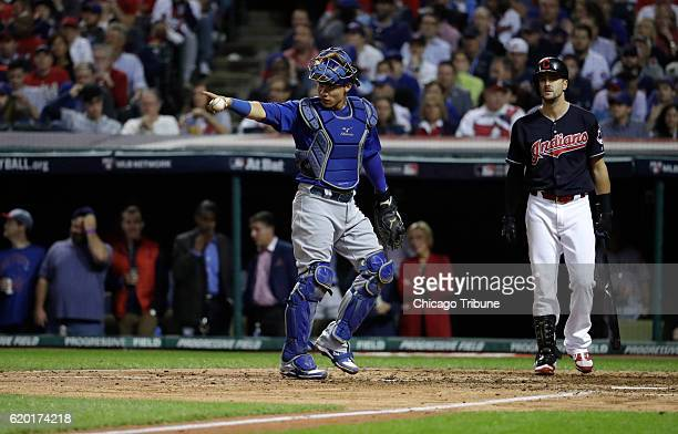 Chicago Cubs catcher Willson Contreras points to starting pitcher Jake Arrieta during the Cleveland Indians' Lonnie Chisenhall at bat in the sixth...