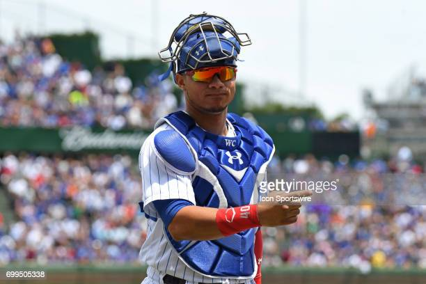 Chicago Cubs catcher Willson Contreras points to the dugout prior to a game between the San Diego Padres and the Chicago Cubs on June 21 at Wrigley...