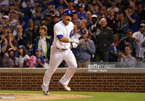 Chicago Cubs catcher Willson Contreras reacts after crossing home plate following his solo home run against the San Diego Padres during the seventh...