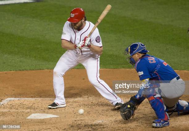 Chicago Cubs catcher Willson Contreras scoops up a low pitch during game five of the NLDS between the Washington Nationals and the Chicago Cubs on...