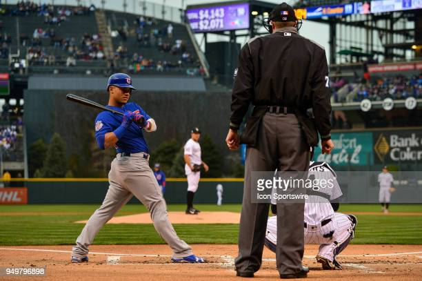 Chicago Cubs catcher Willson Contreras stretches before taking an at bat against the Colorado Rockies in the first inning during a regular season...