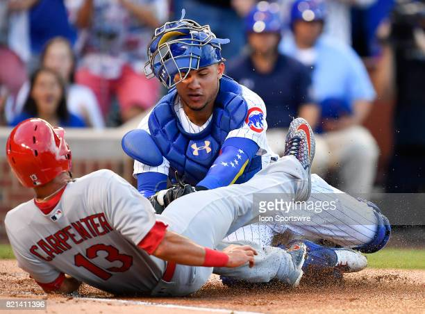 Chicago Cubs catcher Willson Contreras tags out St Louis Cardinals first baseman Matt Carpenter at home plate during the game between the St Louis...