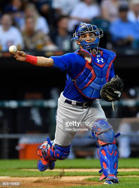 Chicago Cubs catcher Willson Contreras throws the ball to first base for the out during the game between the Chicago Cubs and the Chicago White Sox...