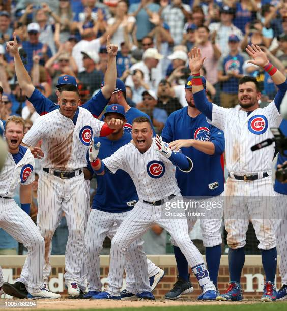 Chicago Cubs center fielder Albert Almora Jr and teammates wait for Anthony Rizzo at the plate after Rizzo's walkoff home run in the ninth inning...