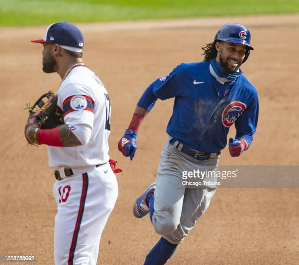 Chicago Cubs center fielder Billy Hamilton circles the bases with a home run and passes Chicago White Sox third baseman Yoan Moncada in the fourth...
