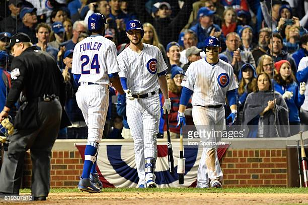 Chicago Cubs center fielder Dexter Fowler celebrates his home run with Chicago Cubs third baseman Kris Bryant and Chicago Cubs first baseman Anthony...