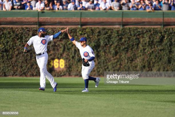 Chicago Cubs center fielder Jon Jay right is congratulated by Chicago Cubs right fielder Jason Heyward after Jay made a great catch to end the top of...