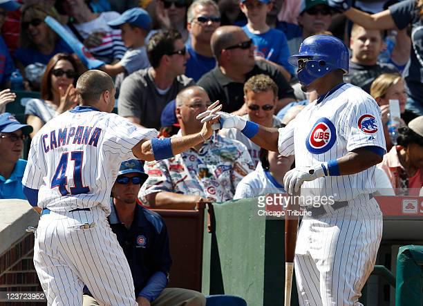 Chicago Cubs center fielder Marlon Byrd congratulates center fielder Tony Campana who scored on an error by Pittsburgh Pirates first baseman Derrek...