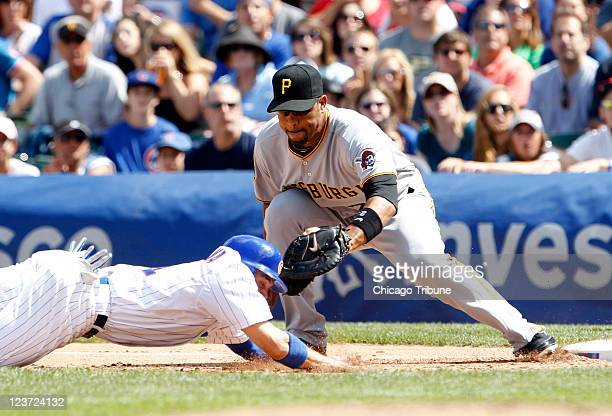 Chicago Cubs center fielder Tony Campana gets picked off by Pittsburgh Pirates first baseman Derrek Lee during the first inning at Wrigley Field in...