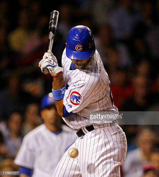 Chicago Cubs' Derrek Lee gets hit by a pitch from Cincinnati Reds pitcher Bronson Arroyo during game action at Wrigley Field in Chicago Illinois...