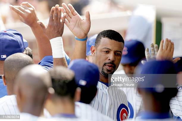 Chicago Cubs' Derrek Lee scores on Michael Barrett's sacrifice fly to right in the first inning. The Cubs defeated the Reds 4-1 at Wrigley Field in...