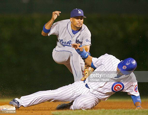 Chicago Cubs' Derrek Lee steals second on a wild pitch as Los Angeles Dodgers' Rafael Furcal tries to tag him out in the fifth inning at Wrigley...