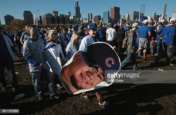Chicago Cubs fan carries a picture of Kyle Schwarber a a rally in Grant Park held to celebrate the team's World Series victory on November 4 2016 in...