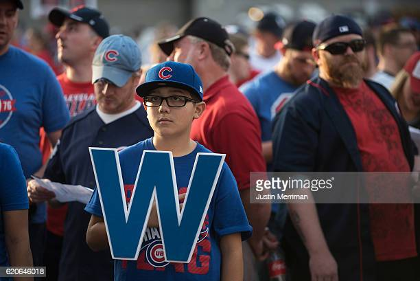 Chicago Cubs fan Christian Walkowiak of New Lenox Ill waits in line to get into Progressive Field before the start of Game 7 of the World Series...