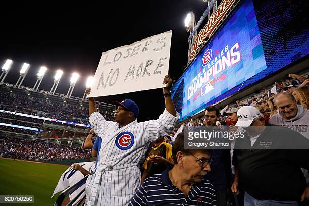 Chicago Cubs fan holds a sign after the Cubs defeated the Cleveland Indians 87 in Game Seven of the 2016 World Series at Progressive Field on...