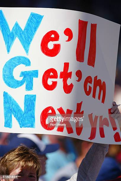 A Chicago Cubs fan holds up a sign during the game against the Atlanta Braves at Wrigley Field on October 3 2004 in Chicago Illinois The Cubs...