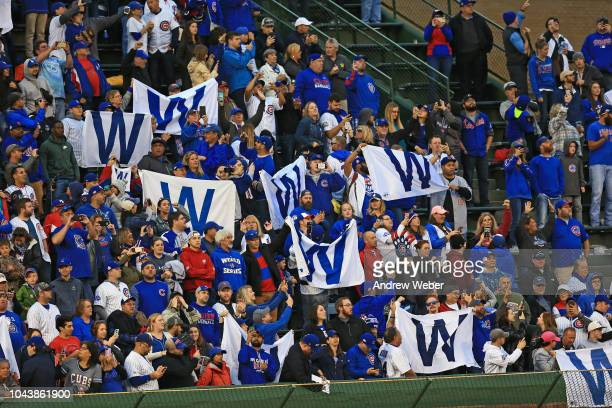 Chicago Cubs fans celebrate after beating the St Louis Cardinals 105 at Wrigley Field on September 30 2018 in Chicago Illinois