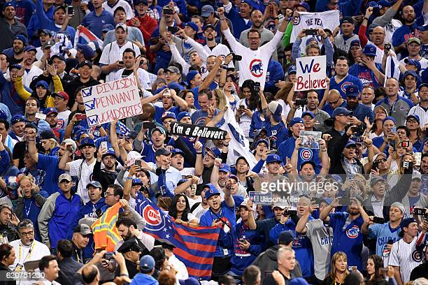 Chicago Cubs fans celebrate after the Cubs defeated the Cleveland Indians 87 in Game Seven of the 2016 World Series at Progressive Field on November...