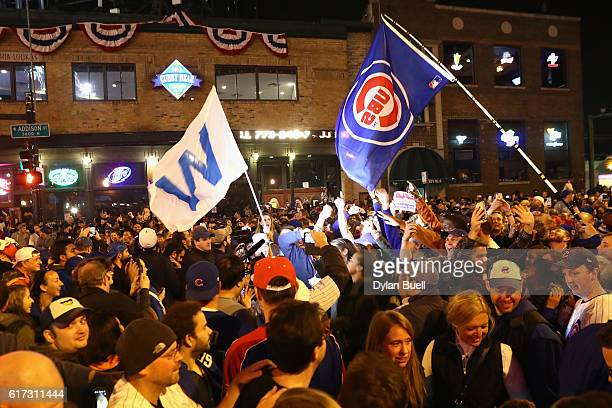 Chicago Cubs fans celebrate outside of Wrigley Field after the Chicago Cubs defeated the Los Angeles Dodgers 50 in game six of the National League...