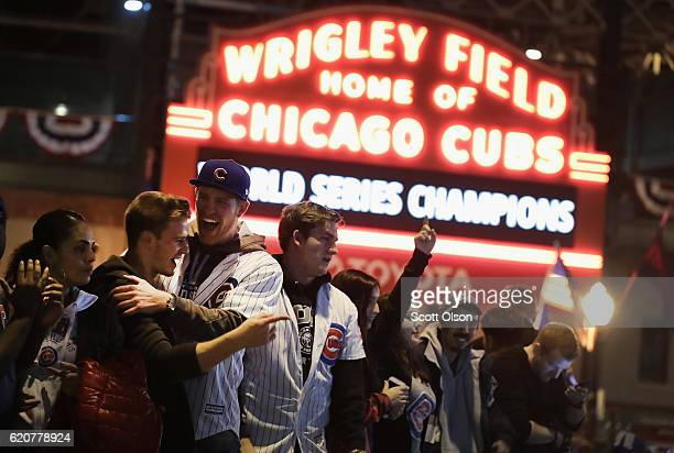 Chicago Cubs fans celebrate outside Wrigley Field after the Cubs defeated the Cleveland Indians in game seven of the 2016 World Series on November 2,...