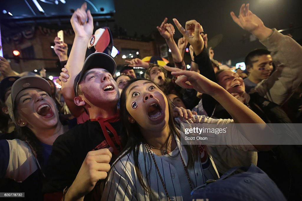 Chicago Cubs fans celebrate outside Wrigley Field as the Cubs play the Cleveland Indians during game seven of the 2016 World Series on November 2, 2016 in Chicago, Illinois. The Cubs defeated the Indians 8-7 to win their first World Series title since 1908.
