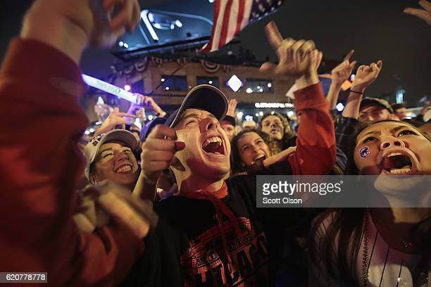 Chicago Cubs fans celebrate outside Wrigley Field as the Cubs play the Cleveland Indians during game seven of the 2016 World Series on November 2...