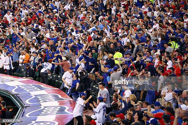 Chicago Cubs fans cheer after a home run in the first inning by Dexter Fowler during Game 7 of the 2016 World Series against the Cleveland Indians at...