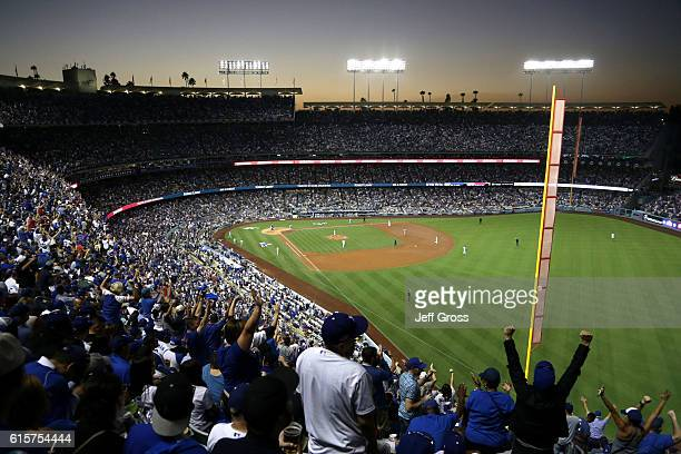Chicago Cubs fans cheer after Addison Russell of the Chicago Cubs hits a tworun home run in the fourth inning against the Los Angeles Dodgers in game...