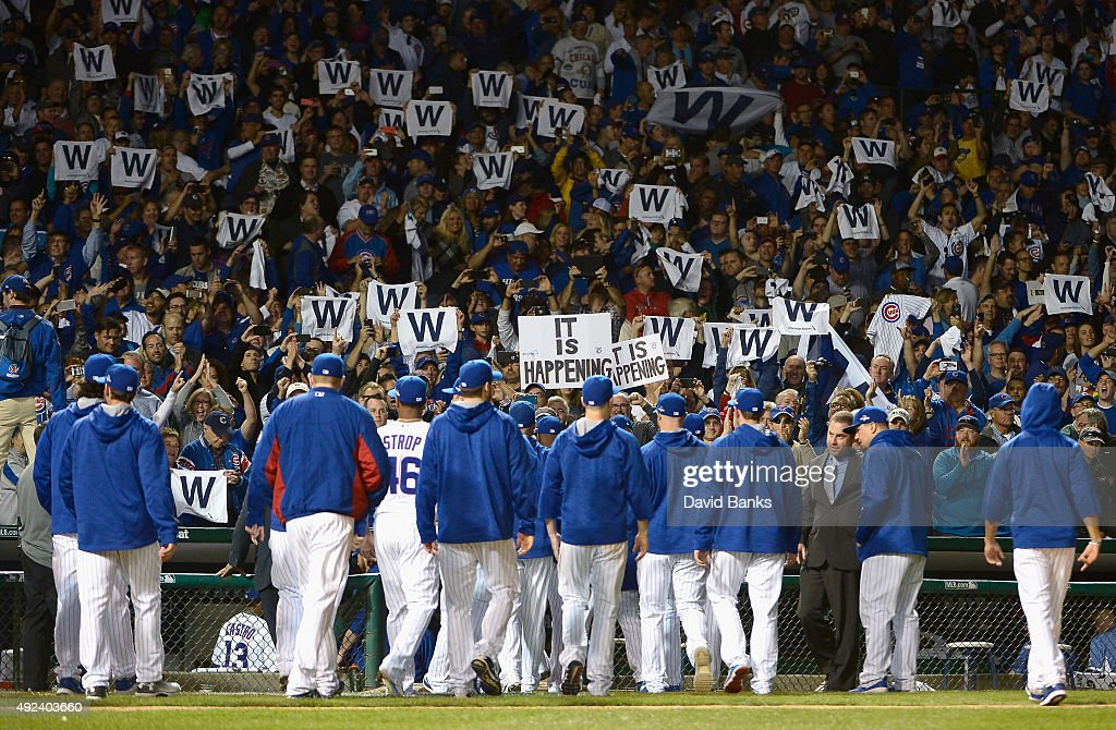 Chicago Cubs fans cheer after the Chicago Cubs defeat the St. Louis Cardinals 8 to 6 in game three of the National League Division Series at Wrigley Field on October 12, 2015 in Chicago, Illinois.