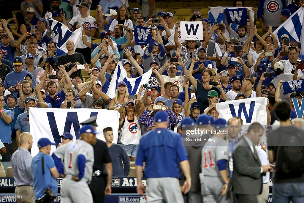 Chicago Cubs fans cheer after the Cubs 8-4 victory against the Los Angeles Dodgers in game five of the National League Division Series at Dodger Stadium on October 20, 2016 in Los Angeles, California.