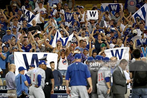 Chicago Cubs fans cheer after the Cubs 84 victory against the Los Angeles Dodgers in game five of the National League Division Series at Dodger...
