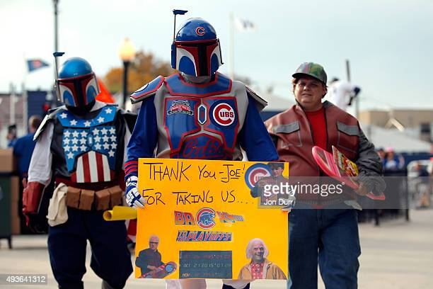 Chicago Cubs fans dressed as Star Wars's Boba Fett and Back to the Future's Marty McFly pose outside the stadium prior to game four of the 2015 MLB...