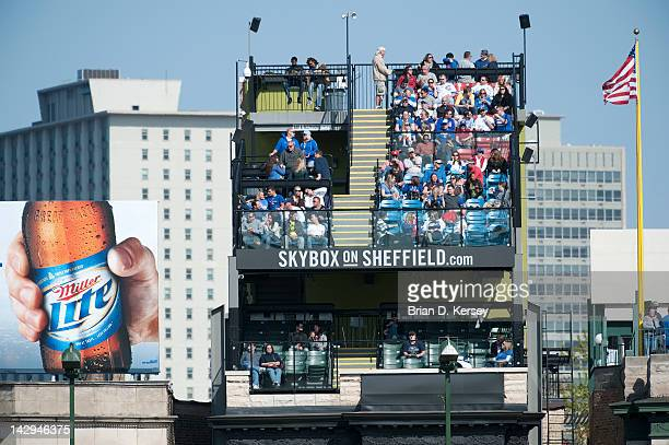 Chicago Cubs fans enjoy the game against the Milwaukee Brewers from one of the Wrigleyville rooftops at Wrigley Field on April 12 2012 in Chicago...