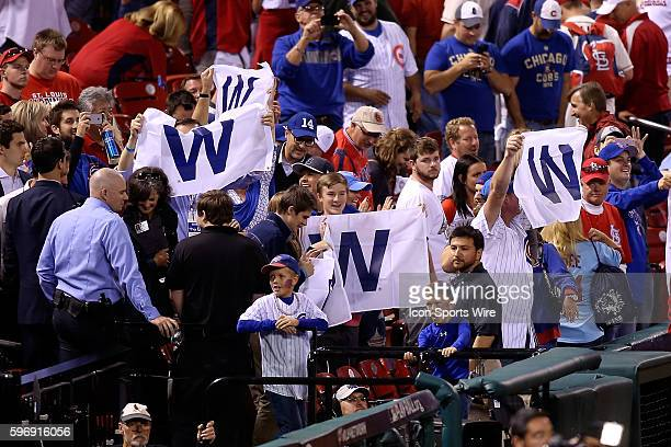 Chicago Cubs fans hold up W flags after the Cubs 63 victory against the St Louis Cardinals during game two of baseball's National League Division...