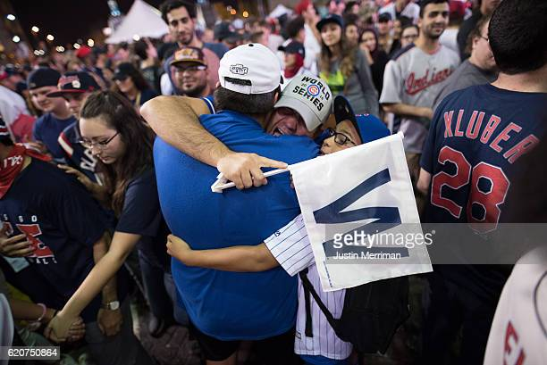 Chicago Cubs fans hug outside of Progressive Field after game 7 of the World Series between the Cleveland Indians and the Chicago Cubs on November 2...