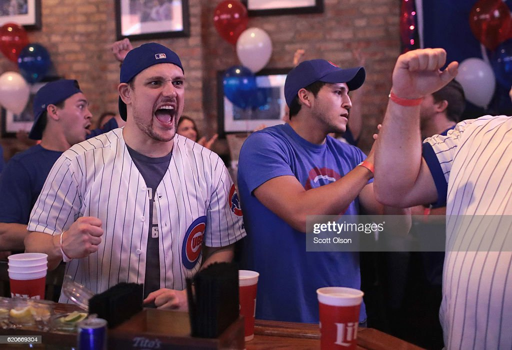 Chicago Cubs fans watch the Chicago Cubs play the Cleveland Indians during game seven of the 2016 World Series at The Stretch bar in the Wrigleyville neighborhood on November 2, 2016 in Chicago, Illinois. The Cubs are looking to secure their first World Series championship since 1908.