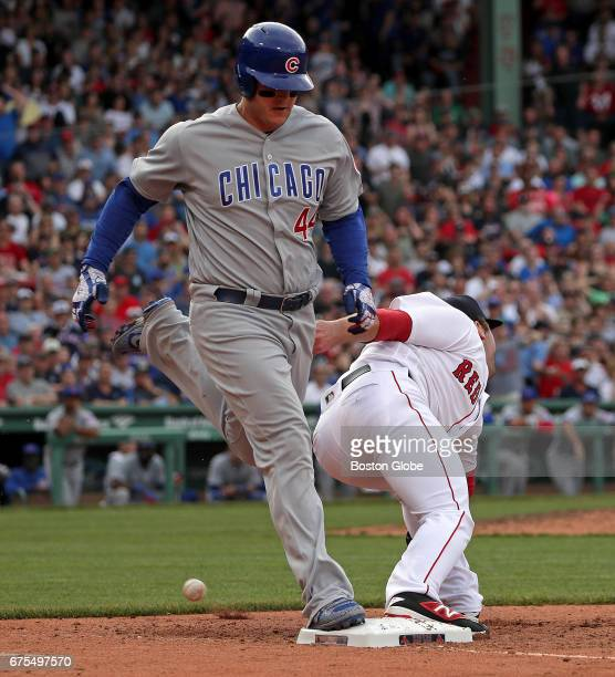 Chicago Cubs first baseman Anthony Rizzo reaches first base on a throwing error by Boston Red Sox shortstop Xander Bogaerts not pictured as the throw...