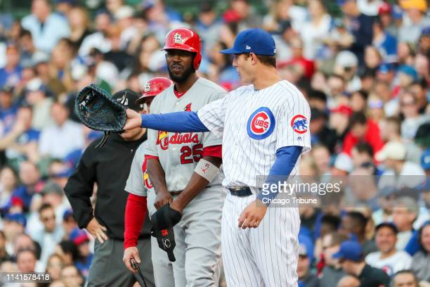 Chicago Cubs first baseman Anthony Rizzo talks with his former teammate St Louis Cardinals right fielder Dexter Fowler after Fowler hit a single...